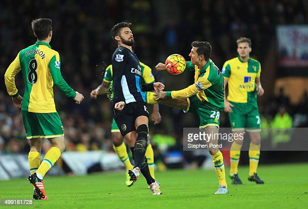 Olivier Giroud of Arsenal and Gary O'Neil of Norwich City battle for the ball during the Barclays Premier League match between Norwich City and...