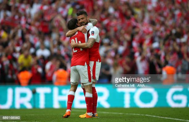 Olivier Giroud of Arsenal and Hector Bellerin of Arsenal celebrate during the Emirates FA Cup Final match between Arsenal and Chelsea at Wembley...