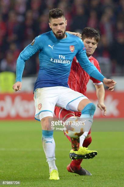 Olivier Giroud of Arsenal and Jorge Mere of Cologne battle for the ball during the UEFA Europa League Group H soccer match between 1FC Cologne and...