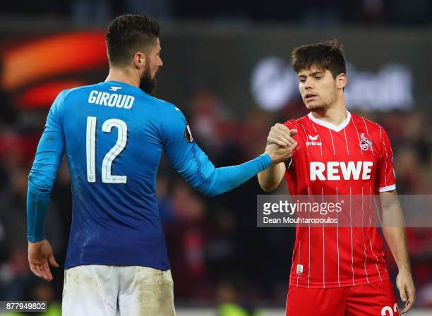Olivier Giroud of Arsenal and Jorge Mere of FC Koeln shake hands after the UEFA Europa League group H match between 1 FC Koeln and Arsenal FC at...