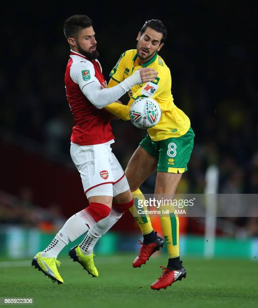 Olivier Giroud of Arsenal and Mario Vrancic of Norwich City during the Carabao Cup Fourth Round match between Arsenal and Norwich City at Emirates...