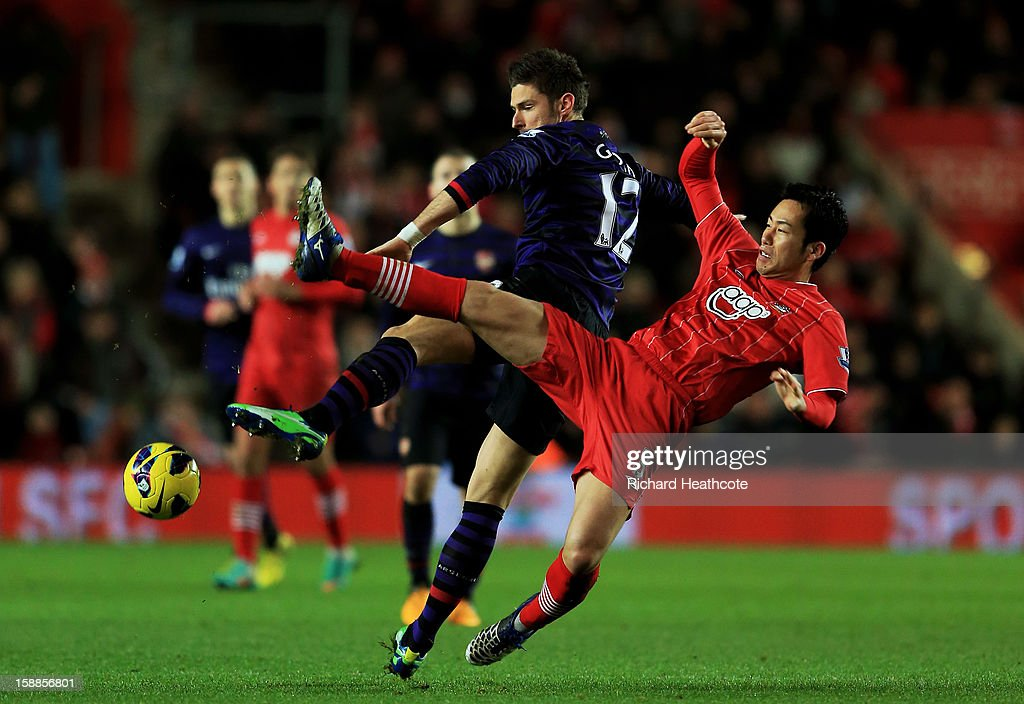 Olivier Giroud of Arsenal and Maya Yoshida of Southampton compete for the ball during the Barclays Premier league match between Southampton and Arsenal at St Mary's Stadium on January 1, 2013 in Southampton, England.