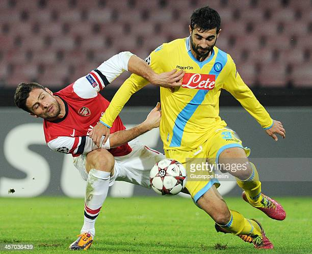 Olivier Giroud of Arsenal and Raul Albiol of Napoli in action during the UEFA Champions League Group F match between SSC Napoli and Arsenal at Stadio...