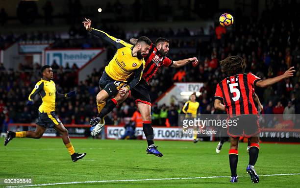 Olivier Giroud of Arsenal and Steve Cook of AFC Bournemouth compete for the ball during the Premier League match between AFC Bournemouth and Arsenal...