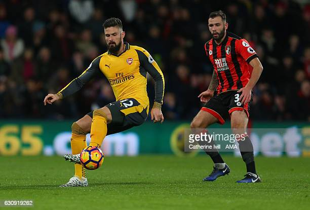 Olivier Giroud of Arsenal and Steve Cook of Bournemouth during the Premier League match between AFC Bournemouth and Arsenal at Vitality Stadium on...