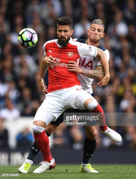 Olivier Giroud of Arsenal and Toby Alderweireld of Tottenham Hotspur compete for the ball during the Premier League match between Tottenham Hotspur...