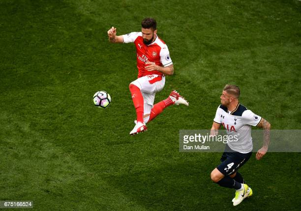 Olivier Giroud of Arsenal attempts to control the ball during the Premier League match between Tottenham Hotspur and Arsenal at White Hart Lane on...