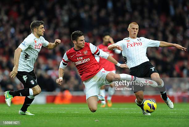 Olivier Giroud of Arsenal battles for the ball with Steve Sidwell of Fulham as Aaron Hughes of Fulham closes in during the Barclays Premier League...