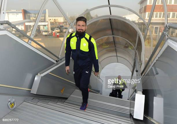 Olivier Giroud of Arsenal boards the flight at Luton Airport on February 14 2017 in Luton England