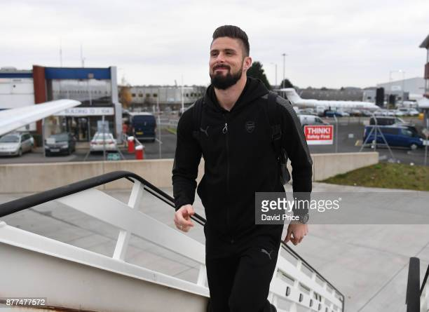 Olivier Giroud of Arsenal boards the plane at Luton Airport on November 22 2017 in Luton England