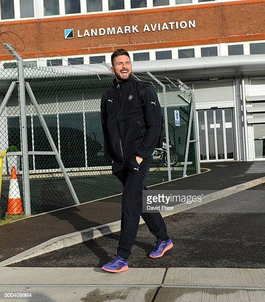 Olivier Giroud of Arsenal boards the plane at Luton Airport on December 8 2015 in Luton England