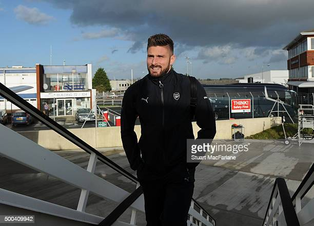 Olivier Giroud of Arsenal boards the team flight to Athens at Luton Airport on December 8 2015 in Luton England Photo by Stuart MacFarlane/Arsenal FC...