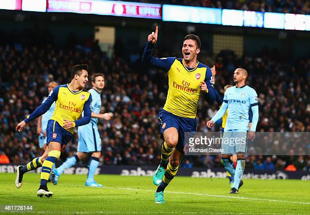Olivier Giroud of Arsenal cekebrates as ge scores their second goal during the Barclays Premier League match between Manchester City and Arsenal at...