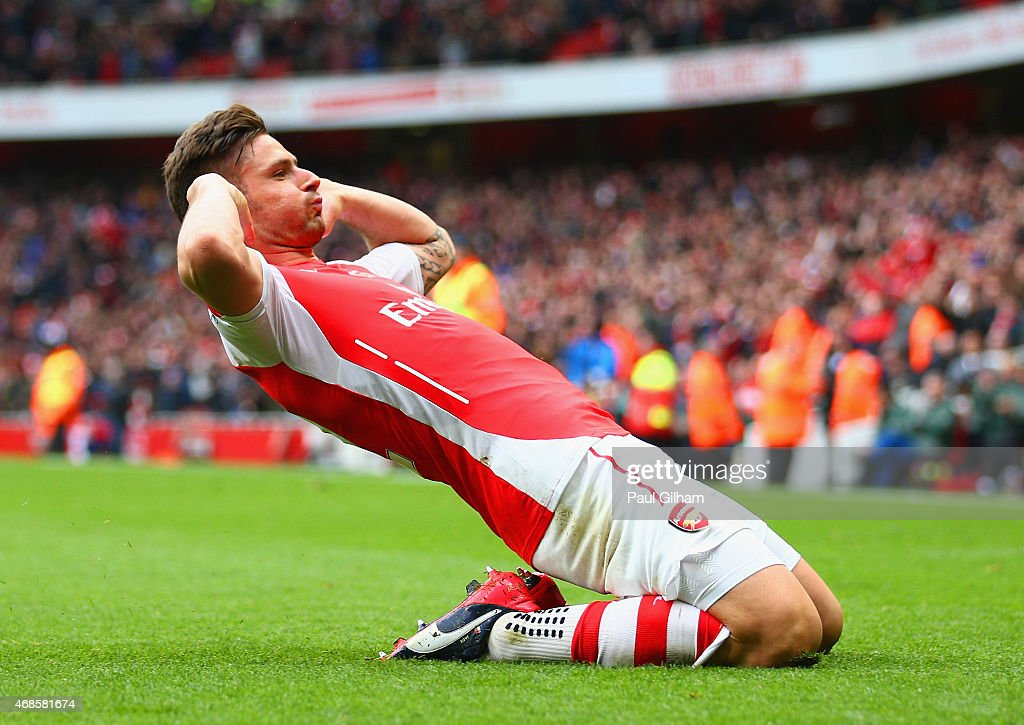 Olivier Giroud of Arsenal celebrates after scoring his team's fourth goal during the Barclays Premier League match between Arsenal and Liverpool at Emirates Stadium on April 4, 2015 in London, England.