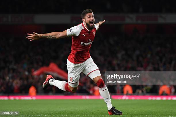 Olivier Giroud of Arsenal celebrates after scoring his team's fourth goal during the Premier League match between Arsenal and Leicester City at the...