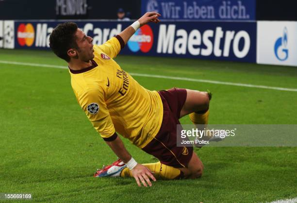 Olivier Giroud of Arsenal celebrates after scoring his team's second goal during the UEFA Champions League group B match between FC Schalke 04 and...