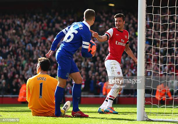 Olivier Giroud of Arsenal celebrates after scoring his team's third goal during the FA Cup QuarterFinal match between Arsenal and Everton at Emirates...