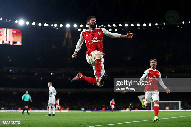 Olivier Giroud of Arsenal celebrates after scoring the opening goal during the Premier League match between Arsenal and West Bromwich Albion at...