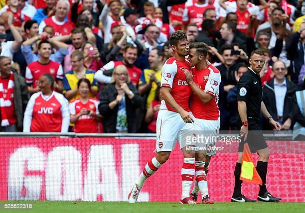 Olivier Giroud of Arsenal celebrates after scoring to make it 30 with Aaron Ramsey of Arsenal