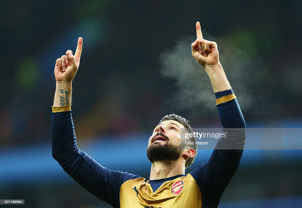 Olivier Giroud of Arsenal celebrates as he scores their first goal from a penalty during the Barclays Premier League match between Aston Villa and Arsenal at Villa Park on December 13, 2015 in Birmingham, England.