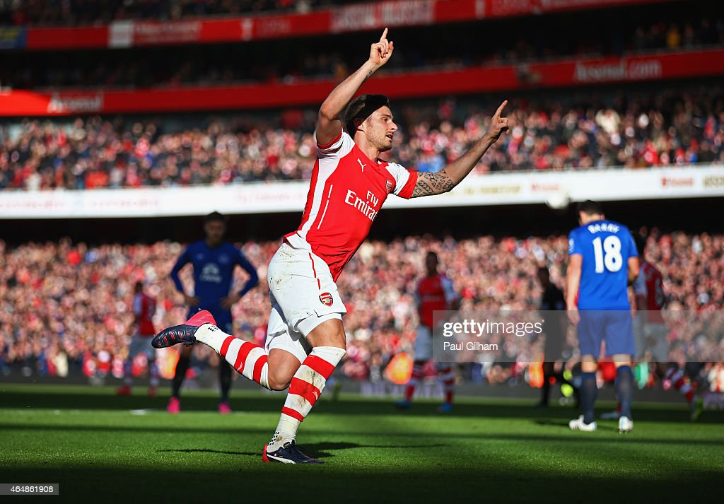 Olivier Giroud of Arsenal celebrates as he scores their first goal during the Barclays Premier League match between Arsenal and Everton at Emirates Stadium on March 1, 2015 in London, England.