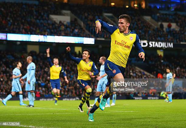 Olivier Giroud of Arsenal celebrates as he scores their second goal during the Barclays Premier League match between Manchester City and Arsenal at...