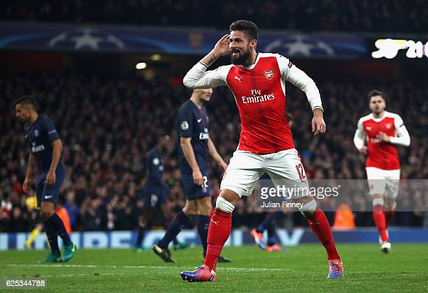 Olivier Giroud of Arsenal celebrates his sides second goal after Marco Verratti of PSG scored a own goal during the UEFA Champions League Group A...