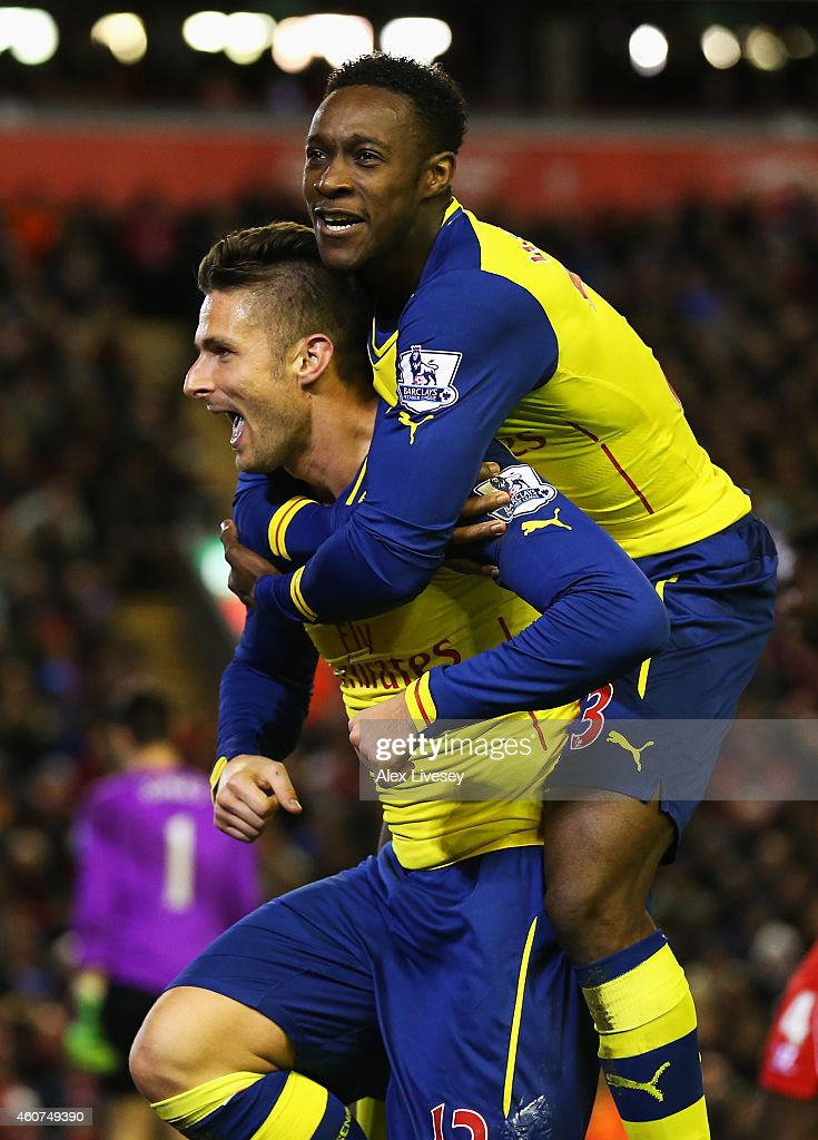 Olivier Giroud of Arsenal celebrates scoring his goal with Danny Welbeck of Arsenal during the Barclays Premier League match between Liverpool and Arsenal at Anfield on December 21, 2014 in Liverpool, England.