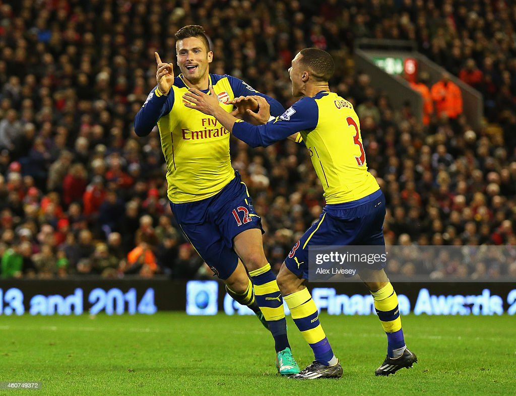 Olivier Giroud of Arsenal celebrates scoring his goal with Kieran Gibbs of Arsenal during the Barclays Premier League match between Liverpool and Arsenal at Anfield on December 21, 2014 in Liverpool, England.