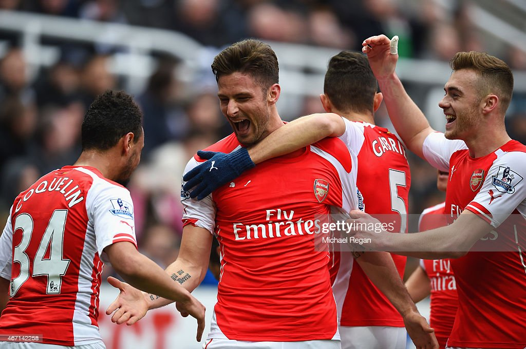 Olivier Giroud of Arsenal celebrates scoring his second goal with Francis Coquelin and Calum Chambers of Arsenal during the Barclays Premier League match between Newcastle United and Arsenal at St James' Park on March 21, 2015 in Newcastle upon Tyne, England.