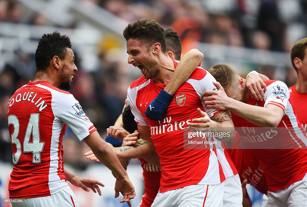 Olivier Giroud of Arsenal celebrates scoring his second goal with Francis Coquelin during the Barclays Premier League match between Newcastle United and Arsenal at St James' Park on March 21, 2015 in Newcastle upon Tyne, England.