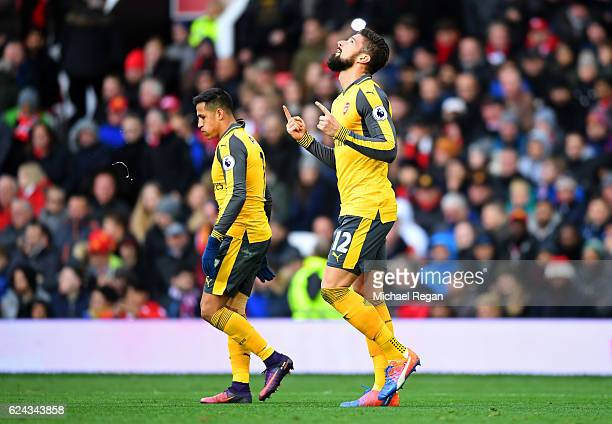 Olivier Giroud of Arsenal celebrates scoring his sides first goal during the Premier League match between Manchester United and Arsenal at Old...