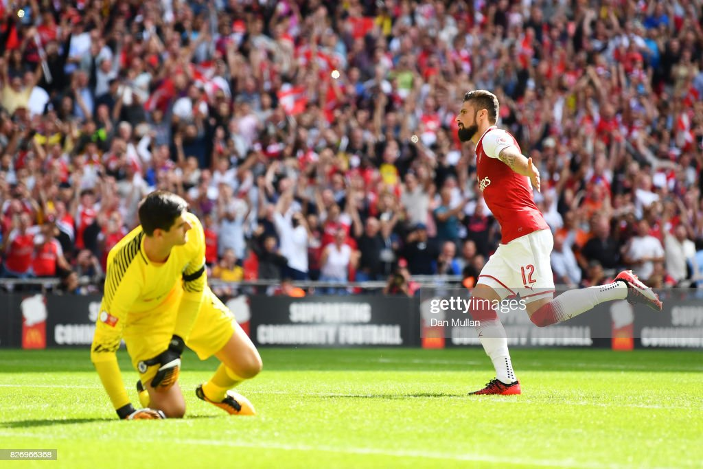 Olivier Giroud of Arsenal celebrates scoring his sides fourth penalty in the penalty shoot out during the The FA Community Shield final between Chelsea and Arsenal at Wembley Stadium on August 6, 2017 in London, England.