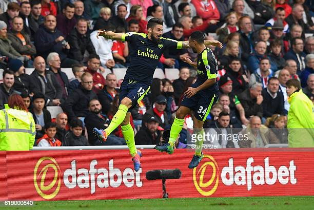 Olivier Giroud of Arsenal celebrates scoring his sides second goal with his team mate Francis Coquelin during the Premier League match between...