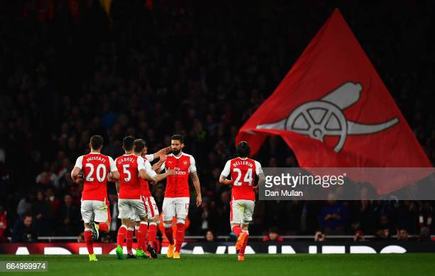 Olivier Giroud of Arsenal celebrates scoring his sides third goal with his Arsenal team mates during the Premier League match between Arsenal and...