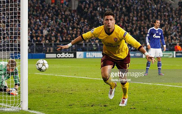 Olivier Giroud of Arsenal celebrates scoring his team's second goal during the UEFA Champions League group B match between FC Schalke 04 and Arsenal...