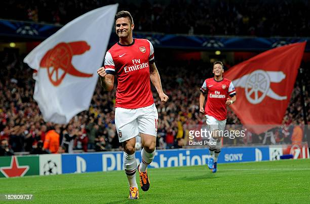 Olivier Giroud of Arsenal celebrates scoring his team's second goal during the UEFA Champions League Group F match between Arsenal FC and SSC Napoli...
