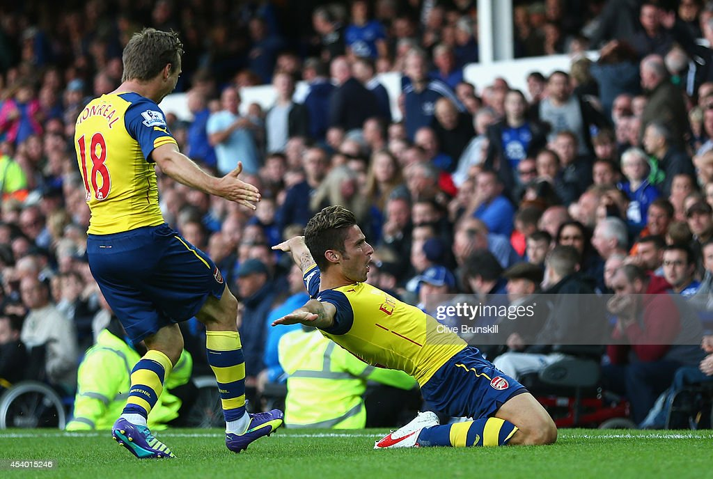 Olivier Giroud of Arsenal celebrates scoring his team's second goal with team-mate Nacho Monreal during the Barclays Premier League match between Everton and Arsenal at Goodison Park on August 23, 2014 in Liverpool, England.