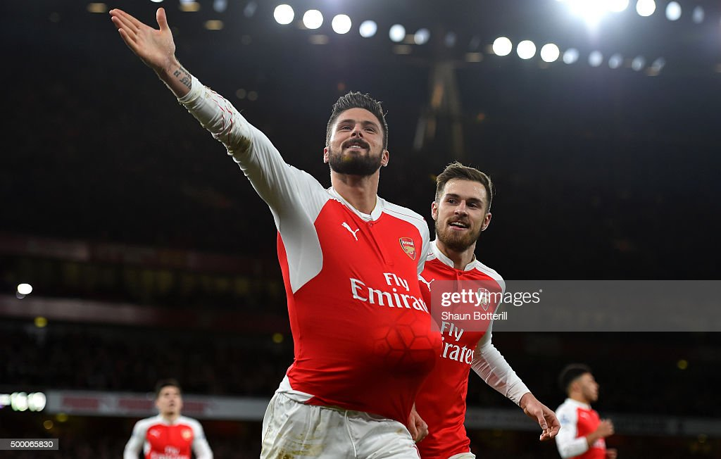 Olivier Giroud (L) of Arsenal celebrates scoring his team's second goal with his team mate Aaron Ramsey (R)during the Barclays Premier League match between Arsenal and Sunderland at Emirates Stadiumon December 5, 2015 in London, England.
