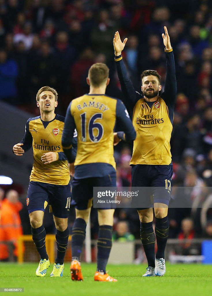 Olivier Giroud (R) of Arsenal celebrates scoring his team's second goal during the Barclays Premier League match between Liverpool and Arsenal at Anfield on January 13, 2016 in Liverpool, England.