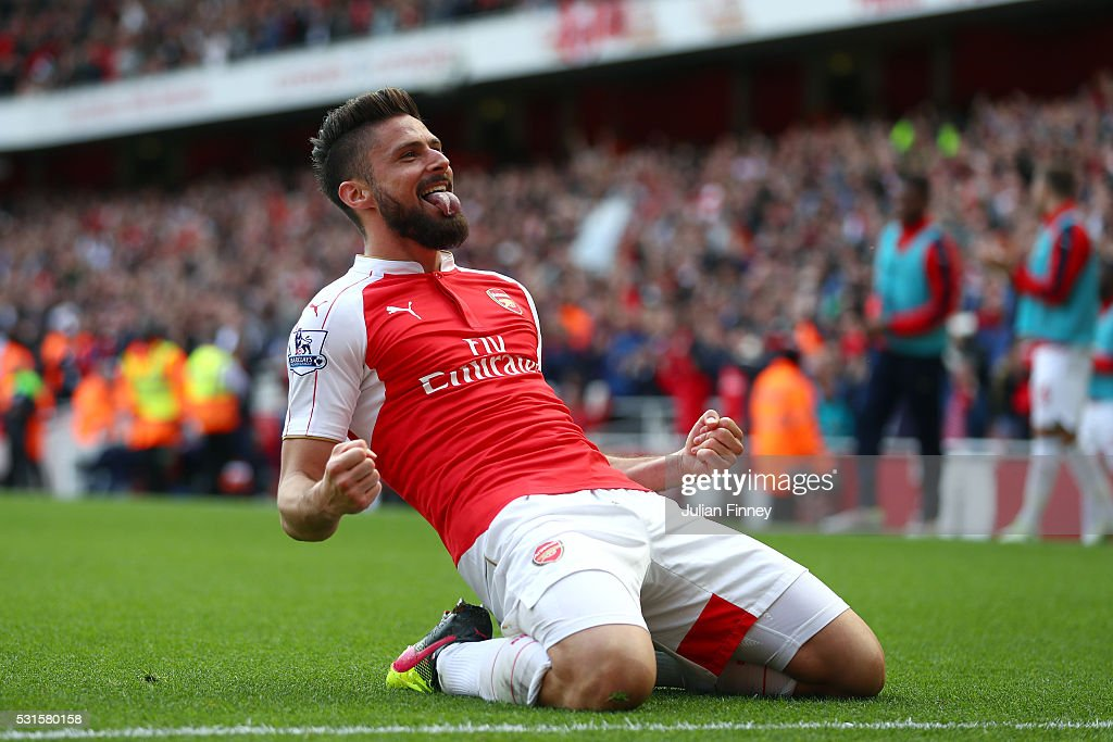 Olivier Giroud of Arsenal celebrates scoring his team's second goal during the Barclays Premier League match between Arsenal and Aston Villa at Emirates Stadium on May 15, 2016 in London, England.