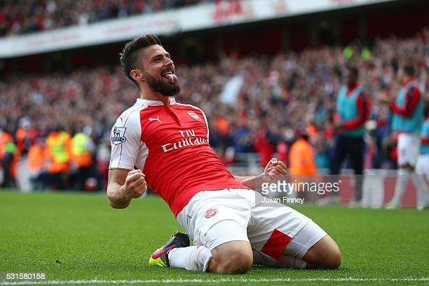 Olivier Giroud of Arsenal celebrates scoring his team's second goal during the Barclays Premier League match between Arsenal and Aston Villa at...