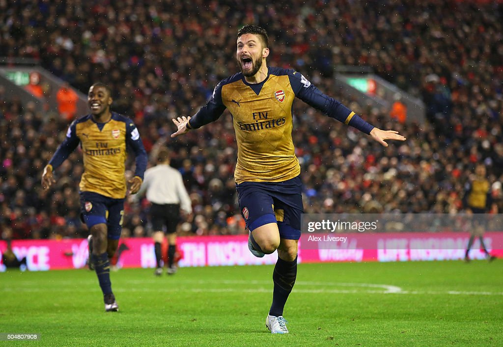 Olivier Giroud of Arsenal celebrates scoring his team's third goal during the Barclays Premier League match between Liverpool and Arsenal at Anfield on January 13, 2016 in Liverpool, England.