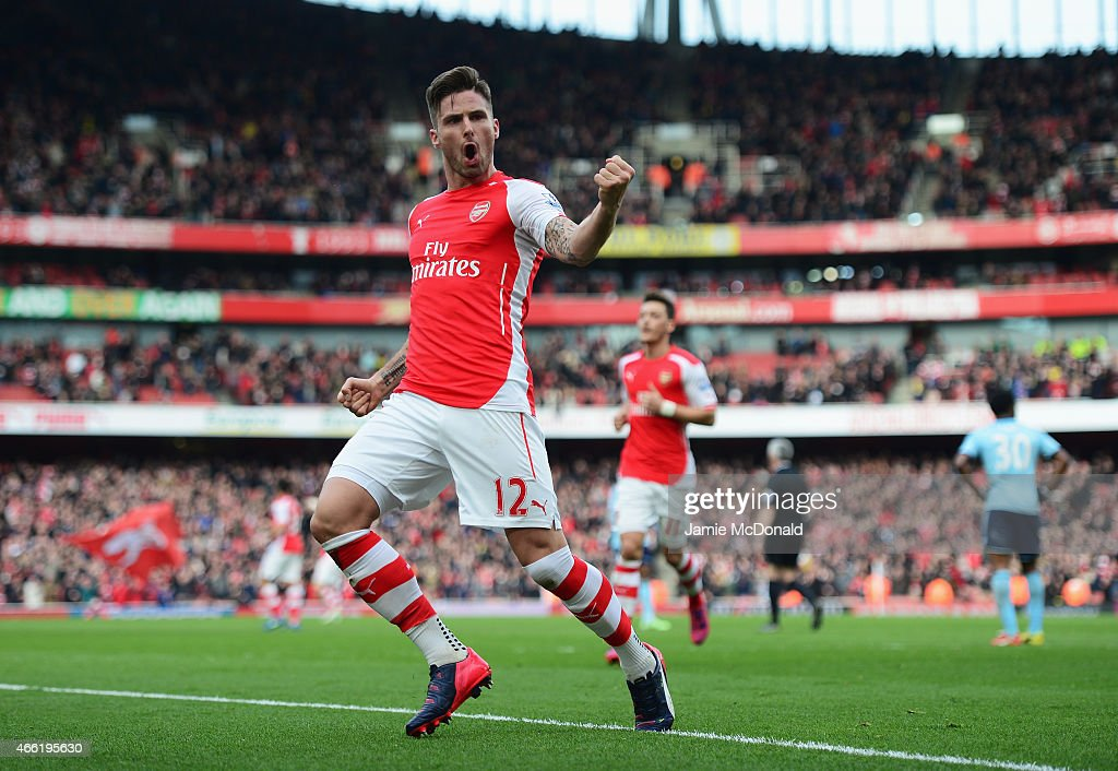 Olivier Giroud of Arsenal celebrates scoring the opening goal during the Barclays Premier League match between Arsenal and West Ham United at Emirates Stadium on March 14, 2015 in London, England.