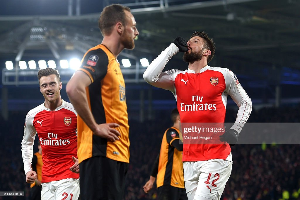 Olivier Giroud of Arsenal celebrates scoring the opening goal during the Emirates FA Cup Fifth Round Replay match between Hull City and Arsenal at KC Stadium on March 8, 2016 in Hull, England.