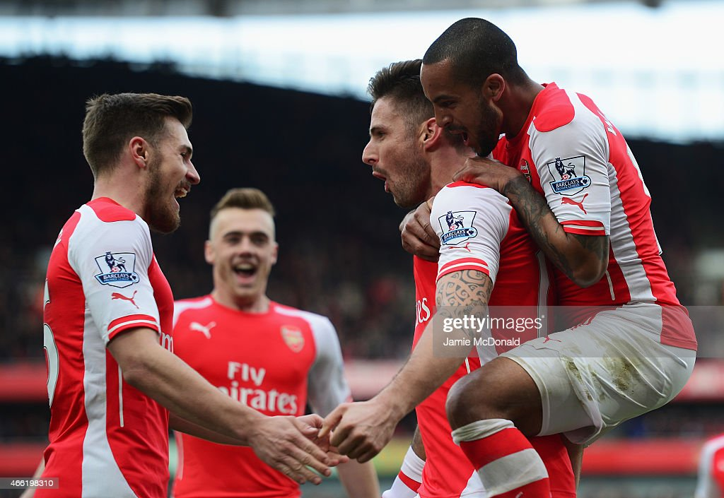 Olivier Giroud of Arsenal celebrates scoring the opening goal with Theo Walcott (R) and Aaron Ramsey during the Barclays Premier League match between Arsenal and West Ham United at Emirates Stadium on March 14, 2015 in London, England.