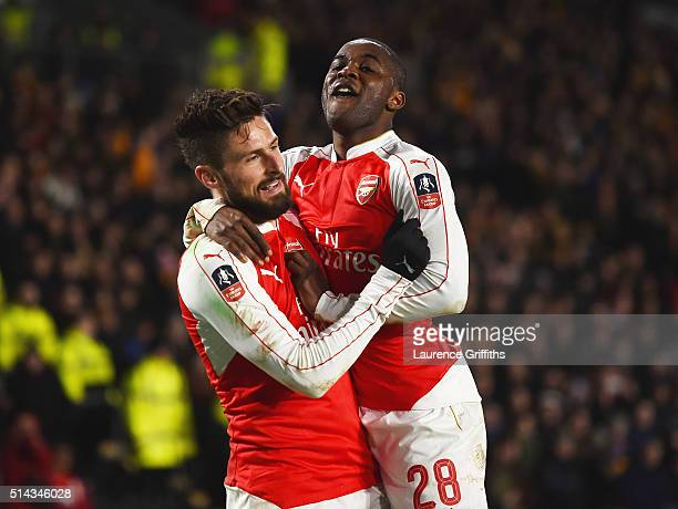 Olivier Giroud of Arsenal celebrates scoring the second Arsenal goal with Joel Campbell during the Emirates FA Cup Fifth Round Replay match between...