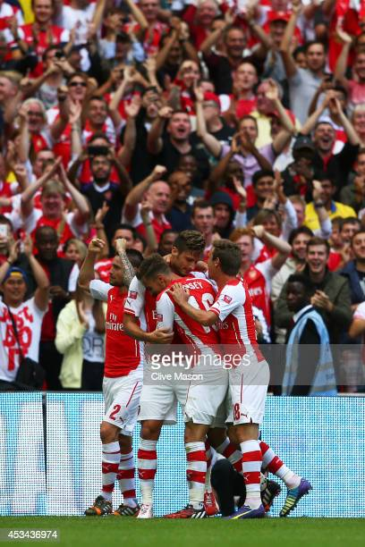 Olivier Giroud of Arsenal celebrates scoring the third goal with his teammates during the FA Community Shield match between Manchester City and...