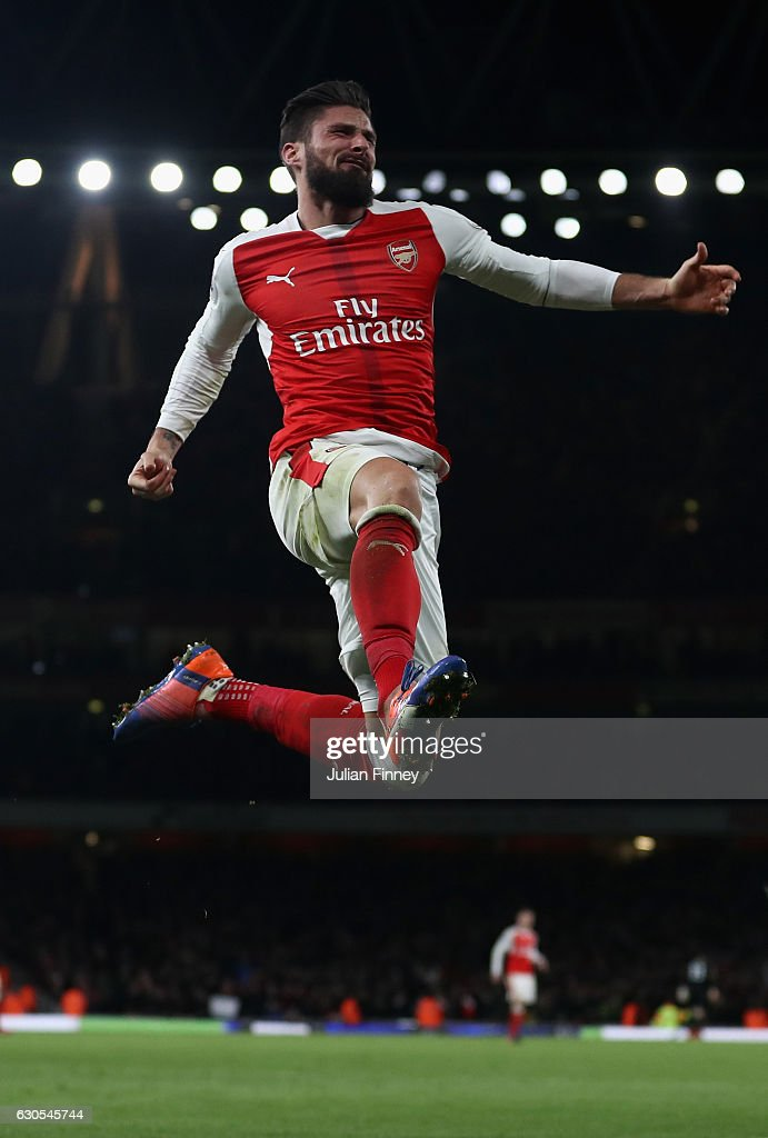 Olivier Giroud of Arsenal celebrates scoring the winning goal during the Premier League match between Arsenal and West Bromwich Albion at Emirates Stadium on December 26, 2016 in London, England.