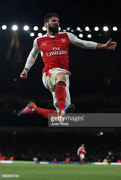 Olivier Giroud of Arsenal celebrates scoring the winning goal during the Premier League match between Arsenal and West Bromwich Albion at Emirates...